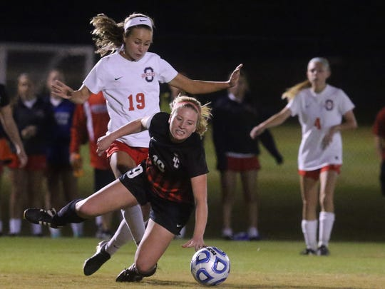 Oakland's Katie Webb (19) and Stewart Creek's Kaitlin Watson (19) both fight to get the ball during the 7-AAA semifinals at Siegel Soccer field  on Tuesday, Oct. 11, 2016.