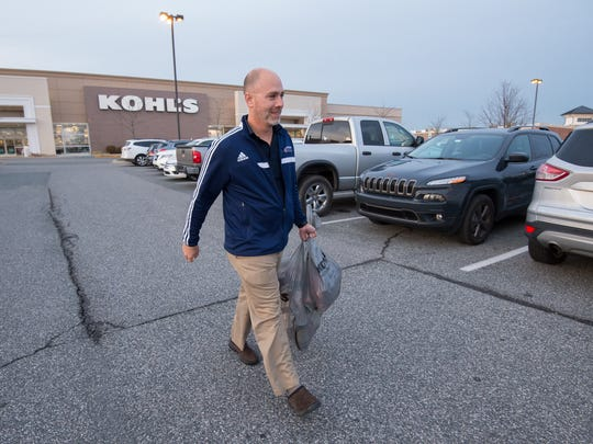 Pat Williams of Middletown walks out of Kohl's in Middletown with Christmas gifts that he purchased for his family.