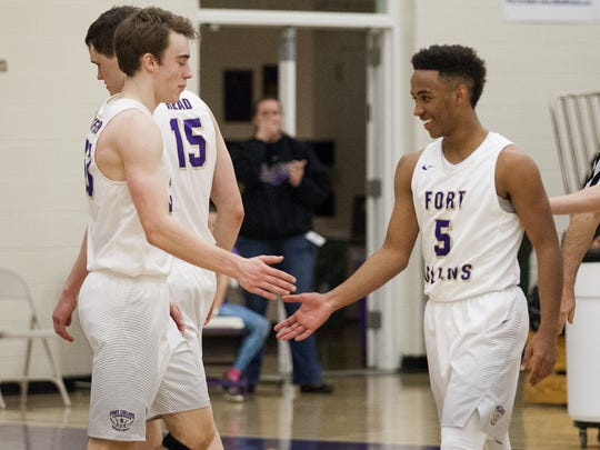 Fort Collins seniors Iseri Palacio (5), right, and Jacob Pfaffinger (33), left, celebrate in a gamer earlier this season. Pfaffinger and Palacio are the top-two scorers for the Lambkins, who are in the Great Eight for the first time since 1988.