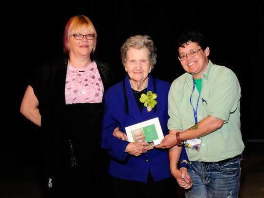 Winner Frances Parish, center, and pageant coordinators