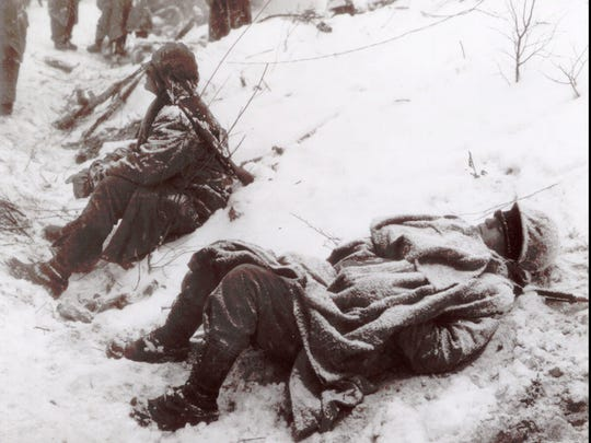 """United States Marines sit covered with ice and snow in this handout photograph taken at the Battle of Chosin Reservoir in North Korea in December of 1950. Thousands of veterans of """"Frozen Chosin"""", as the two-week-long battle is sometimes referred to, suffered frostbite in 30-below-zero temperatures."""