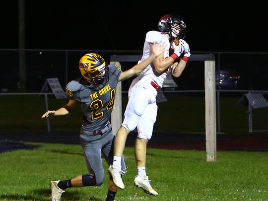 Rosecrans' Hudson Moore pulls in a pass as he's defended by Berne Union's Chance Schwalbach Friday, at Berne Union High School in Sugar Grove.