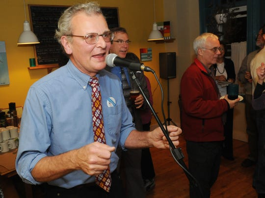 Candidate Cecil Bothwell encourages his supporters gathered at Early Girl Eatery on Wall Street after viewing early returns in 2009.