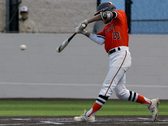 Burkburnett's Jacob Acheson makes contact in the game against Iowa Park Friday, April 20, 2018, in Iowa Park.