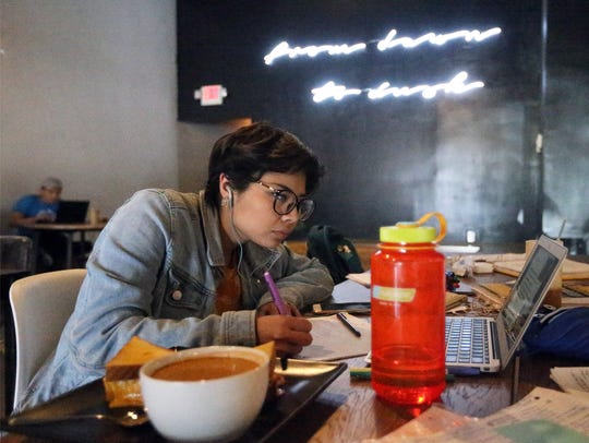Cristy Rodriguez, a nursing student at UTEP does homework