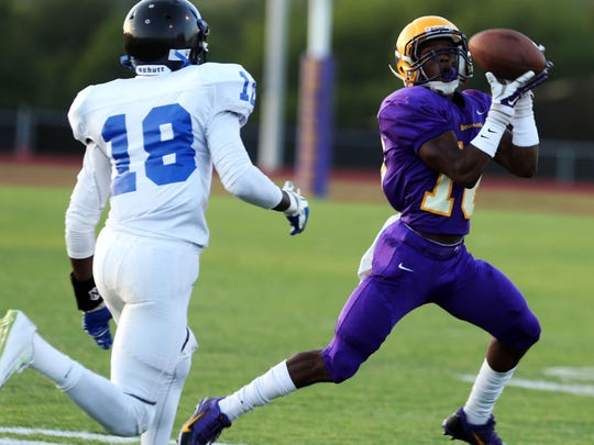 Smyrna's DJ Williams intercepts a pass intended for