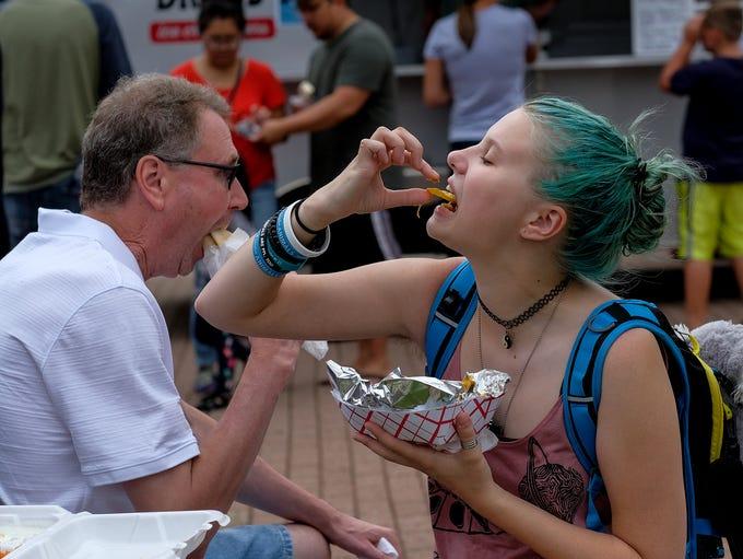 Grace Smith-Jobski enjoys her pulled pork nachos from