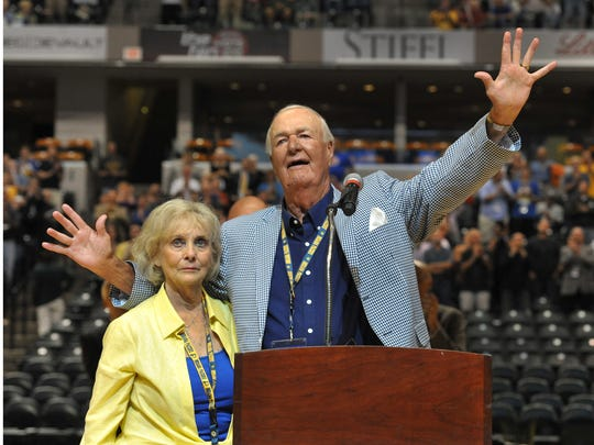 """Bobby """"Slick"""" Leonard and wife Nancy, acknowledge applause from the crowd as he spoke before the viewing of the documentary """"Heart of a Hoosier"""" at Bankers Life Fieldhouse Tuesday July 29, 2014."""