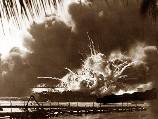 Smoke and flame are seen as the magazine explodes on the destroyer USS Shaw during the Japanese attack on Pearl Harbor, Hawaii, in this Dec. 7, 1941, file photo. (AP Photo/File)