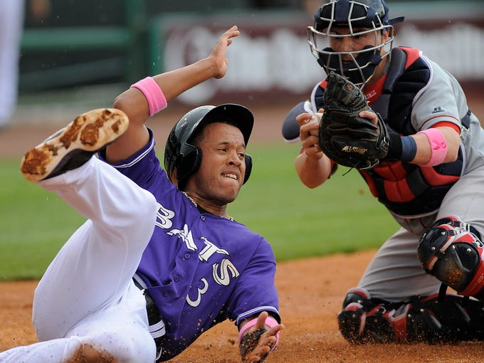 Louisville Bats' Thomas Neal (3) is tagged out at homeplate by Pawtucket Red Sox's Christian Vazquez (right) on Sunday at Louisville Slugger Field. May 11, 2014