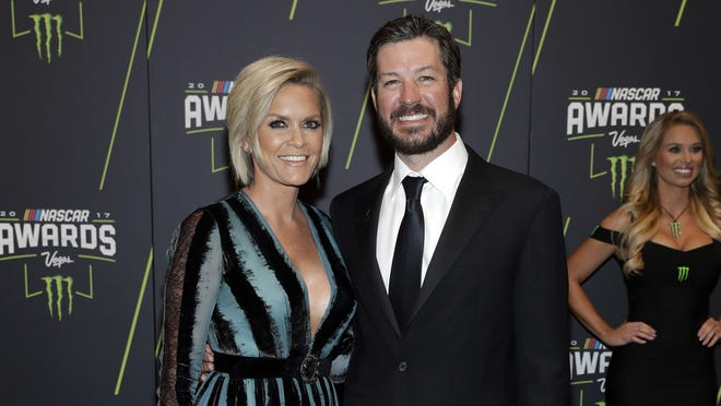 Martin Truex Jr., right, and Sherry Pollex arrive at the NASCAR Cup Series auto racing awards Nov. 30, 2017, in Las Vegas.