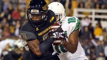 Southern Miss defensive back Cornell Armstrong (3) makes an interception in the end zone in front of North Texas tight end Marcus Smith (18) in the second quarter of a game earlier this season. USM plays for the C-USA West title on Saturday against Louisiana Tech.