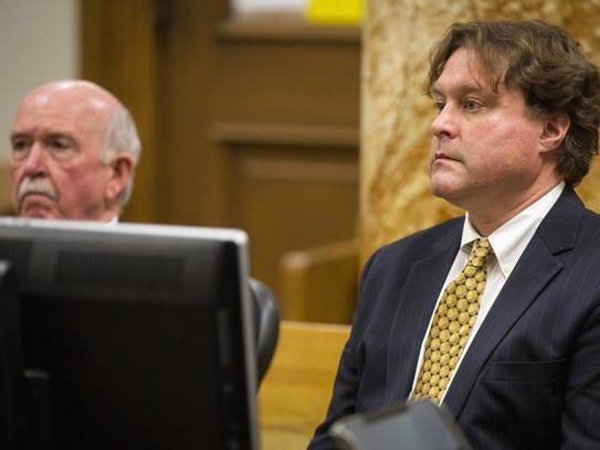 Texas businessman Robert Rhodes (right) faces a judge