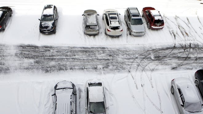 A parking lot off Sycamore Street was covered with snow Wednesday morning.
