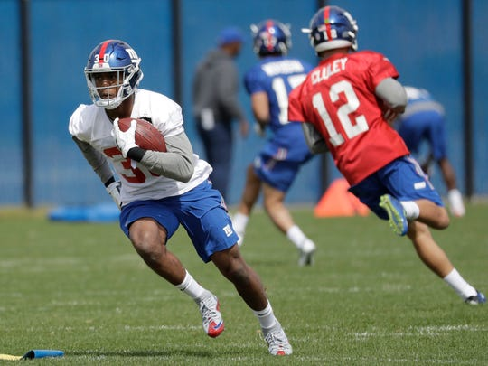 New York Giants' Wayne Gallman runs a drill during NFL football rookie minicamp , Friday, May 12, 2017, in East Rutherford, N.J. (AP Photo/Julio Cortez)