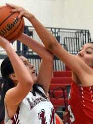 Junior Lady Cat Adriana Giron (14) powered up for a