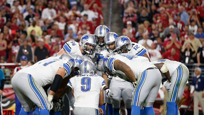 The Detroit Lions huddle around quarterback Matthew Stafford #9 during the fourth quarter of the NFL game against the Arizona Cardinals at the University of Phoenix Stadium on November 16, 2014 in Glendale, Arizona. The Cardinals defeated the Lions 14-6.