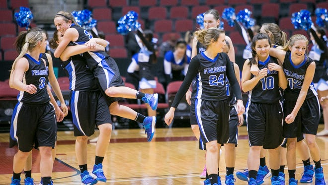 The Fountain Hills girls high school basketball team celebrate their win against Estrella Foothills at their Div. III semifinal game at Jobing.com Arena in Glendale on Friday, February 28, 2014.