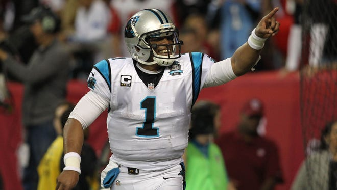 Carolina Panthers quarterback Cam Newton (1) celebrates after a touchdown pass against the Atlanta Falcons in the first quarter at the Georgia Dome.