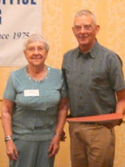 In 2014, Ellie May, chairwoman of the Tompkins County Office for the Aging Advisory Committee, presents the Outstanding Senior Volunteer Award to Bob Spaulding of Caroline.