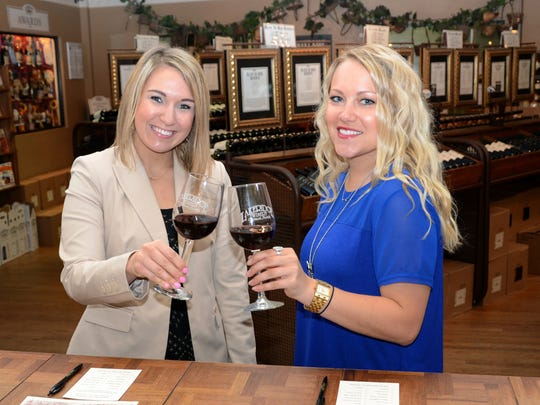 Complimentary wine tastings are offered seven days a week at Lakeridge Winery. Guests are raising a glass during their sampling of wines including the vineyard's most popular, the Southern Red.