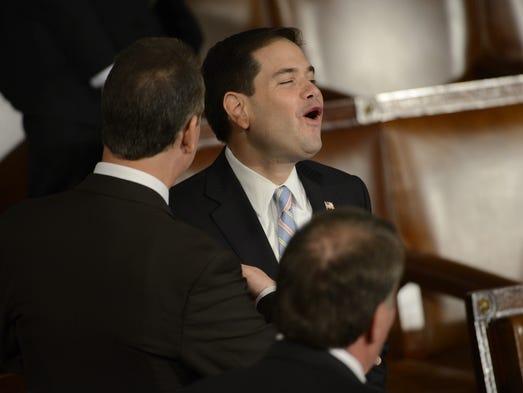 Sen. Marco Rubio, R-Fla., enjoys a laugh following the speech.
