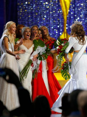 Miss America contestants react after Betty Cantrell, right, of Georgia, was named Miss America 2016, Sunday, Sept. 13, 2015, in Atlantic City, N.J.