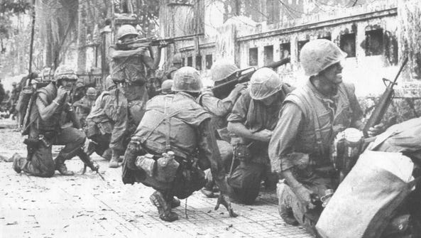 Marines battle North Vietnamese snipers during the