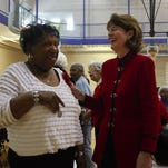 LaVerne Davis, left, talks with Madeline Abramson in 2010 at the Berrytown YMCA, when she was chairwoman of the Y's board.