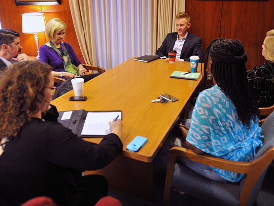 Brendan Bell, top, met with members of the Times Record