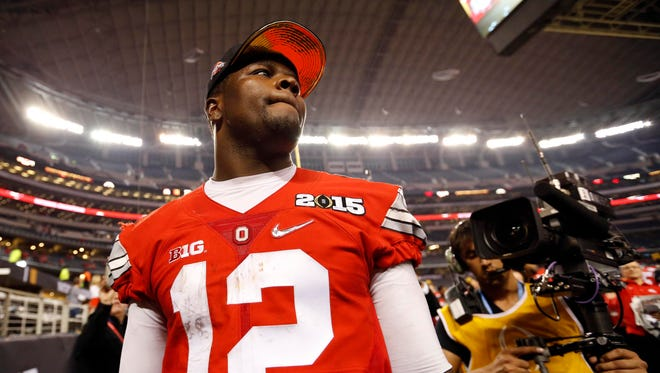Ohio State Buckeyes quarterback Cardale Jones walks off the field after the 2015 CFP National Championship Game.