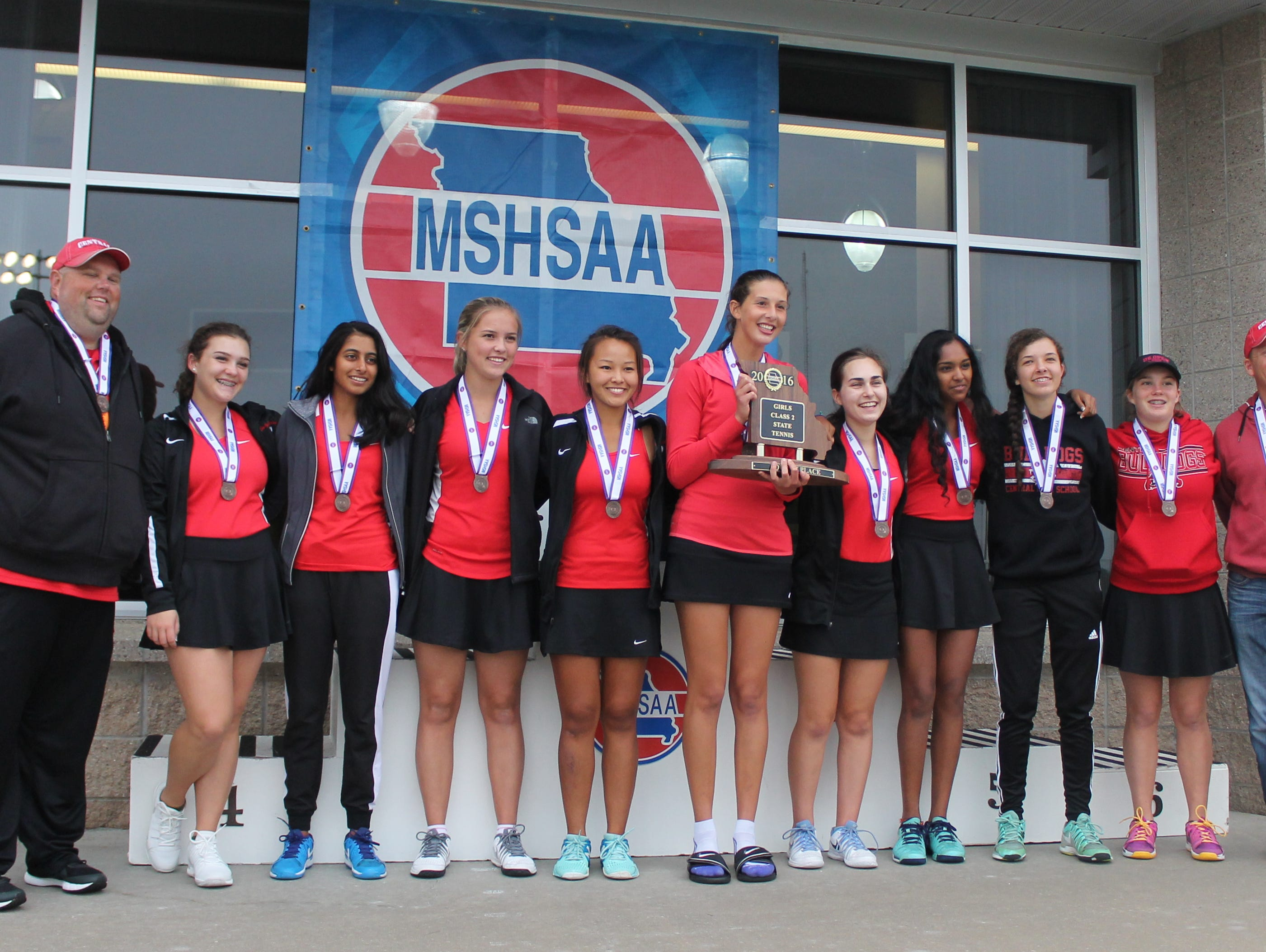 Members of the Central High School tennis team after being awarded fourth place medals at the 2016 state team tennis tournament at Cooper Tennis Complex