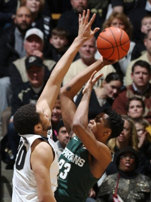 Michigan State Spartans forward Deyonta Davis (23) takes a shot against Purdue Boilermakers center A.J. Hammons (20) at Mackey Arena.