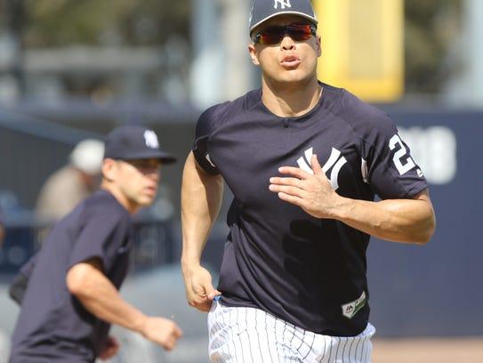 Yankees workout this afternoon. Giancarlo Stanton runs