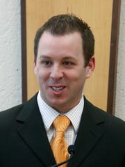 Scott McDonald, the Rochester Institute of Technology women's hockey coach