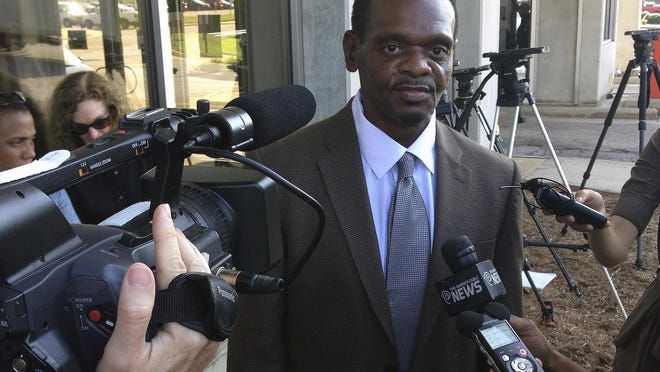 Henry McCollum is released from Central Prison in Raleigh in 2014. Lawyer fees and high-interest loans are threatening the financial futures of the two North Carolina brothers who have collected hundreds of thousands of dollars for their three decades of wrongful imprisonment, a court-appointed advocate said.