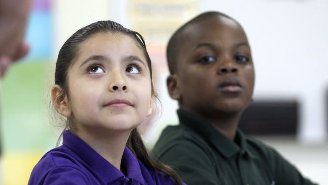 Brisa Ramirez and Jheiden Perkins (right) at Rocketship Southside Community Prep in August 2013.