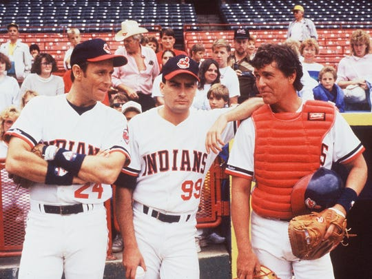 "Corbin Bernsen (from left), Charlie Sheen and Tom Berenger take a break on the sidelines in ""Major League,"" in a scene shot at Milwaukee's now-departed County Stadium."