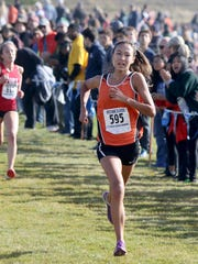 Central Kitsap's Maya Nichols leads Fort Vancouver's Emily Phelps down the final straightway at last Saturday's district meet at Chambers Bay. Nichols' first-place finish helped the Cougars earn a team title.