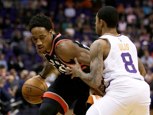 Toronto Raptors guard DeMar DeRozan drives on Phoenix Suns guard Tyler Ulis (8) in the first quarter during an NBA basketball game, Wednesday, Dec 13, 2017, in Phoenix. (AP Photo/Rick Scuteri)