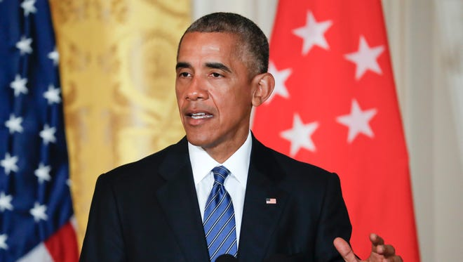 President Obama speak during a joint news conference with Singapore's Prime Minister Lee Hsien Loong in the East Room of the White House Tuesday.