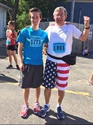 Kalmar poses with grandson Joseph Kalmar, 19, at the Lake Orion Methodist 5K race.