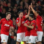 Manchester United's Robin van Persie celebrates his hatrick with his teammates during their Champions League victory against Olympiakos.