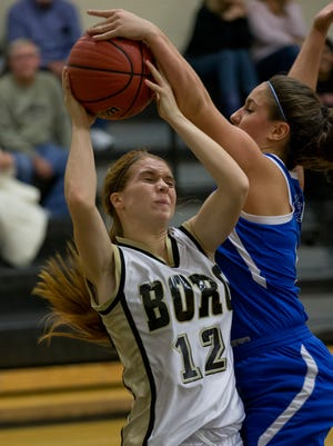 Donovan's Danielle Goble blocks a shot attempt by Point Pleasant Boro's Carlie Ventrini during first half action. Donovan High School vs Point Pleasant Boro High School Girls Basketball at Point Pleasant Boro on December 22, 2015.