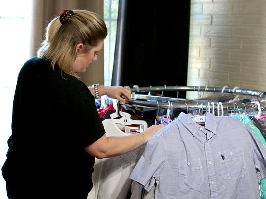 Shannon Turnbo sorts through donated Christmas outfits