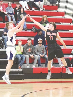 Asher's Mike McDonald hits a three during Thursday night's semifinals of the Pottawatomie County Invitational Tournament.