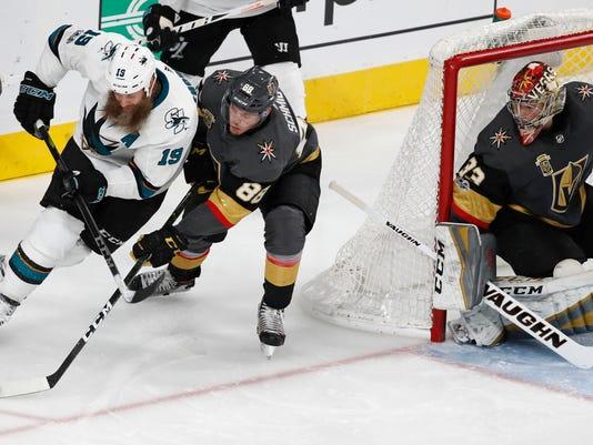 San Jose Sharks center Joe Thornton (19) skates around Vegas Golden Knights defenseman Nate Schmidt (88) during the second period of an NHL hockey game Friday, Nov. 24, 2017, in Las Vegas. (AP Photo/John Locher)
