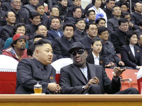 In photo taken February 28, 2013 and released by North Korea's official Korean Central News Agency, North Korean leader Kim Jong-Un (left) and former NBA star Dennis Rodman speak at a basketball game in Pyongyang. Rodman has become the most high-prof