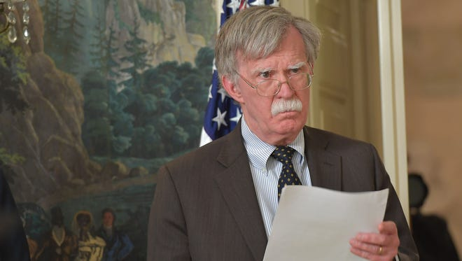 National Security Advisor John Bolton listens as US President Donald Trump addresses the nation on the situation in Syria April 13, 2018 at the White House in Washington, DC.