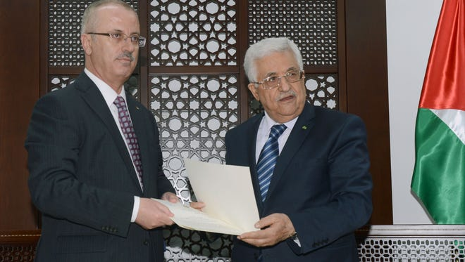 Palestinian President Mahmuod Abbas, right,  meets with Palestinian premier Rami Hamdallah in the West Bank city of Ramallah.